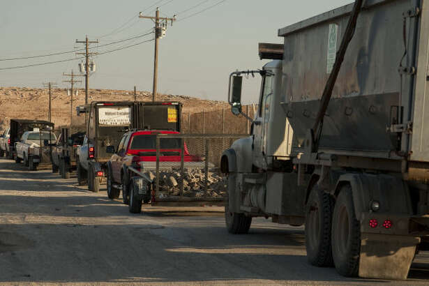 Trucks line up at the City Landfill Friday, 3-13-15, morning as they wait to be weighed before entering. Tim Fischer\Reporter-Telegram