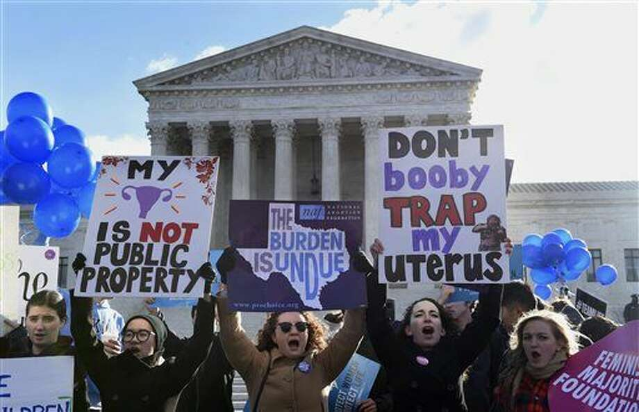 Pro-abortion rights protesters rally outside the Supreme Court in Washington, Wednesday, March 2, 2016. The abortion debate is returning to the Supreme Court in the midst of a raucous presidential campaign and less than three weeks after Justice Antonin Scalia's death. The justices are taking up the biggest case on the topic in nearly a quarter century and considering whether a Texas law that regulates abortion clinics hampers a woman's constitutional right to obtain an abortion. (AP Photo/Susan Walsh) Photo: Susan Walsh