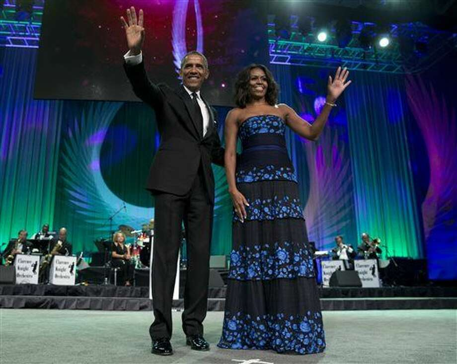FILE - In this Sept. 19, 2015 file photo, President Barack Obama and first lady Michelle Obama arrive at the Congressional Black Caucus Foundation's 45th Annual Legislative Conference Phoenix Awards Dinner at the Walter E. Washington Convention Center in Washington. The president and first lady will make an appearance at the South by Southwest interactive and music festivals in Austin, Texas. The appearances mark the first time a sitting president and first lady have spoken at the annual gathering, a group of conferences on tech, music and film which drew more than 80,000 attendees in 2015. (AP Photo/Carolyn Kaster, File) Photo: Carolyn Kaster