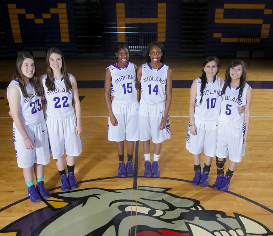 The Midland High girls basketball team has three sets of twins in the varsity lineup. From left, Claudia Fricker (23), Keaton Fricker (22), Alexandrea Washington (15), Alexis Washington (14), Arcie Guardiola (10) and Sadie Guardiola (5). James Durbin/Reporter-Telegram Photo: JAMES DURBIN