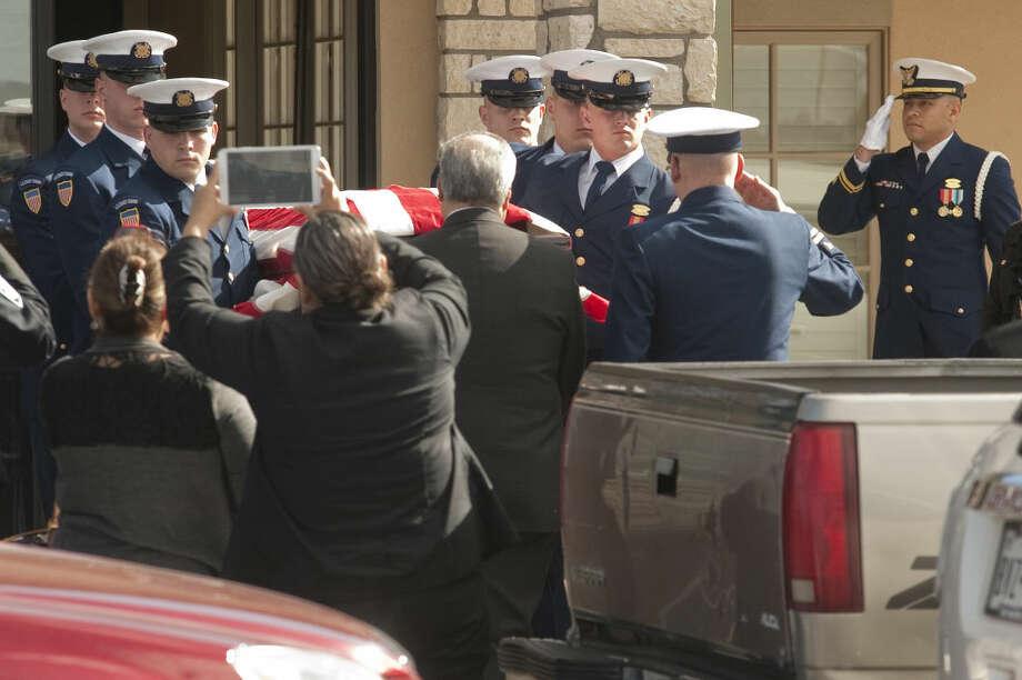 US Coast Guard members salute as Petty Officer Lisa Trubnikova is laid to rest Saturday, 3-14-15 in Midland, Tx. Tim Fischer\Reporter-Telegram Photo: Tim Fischer