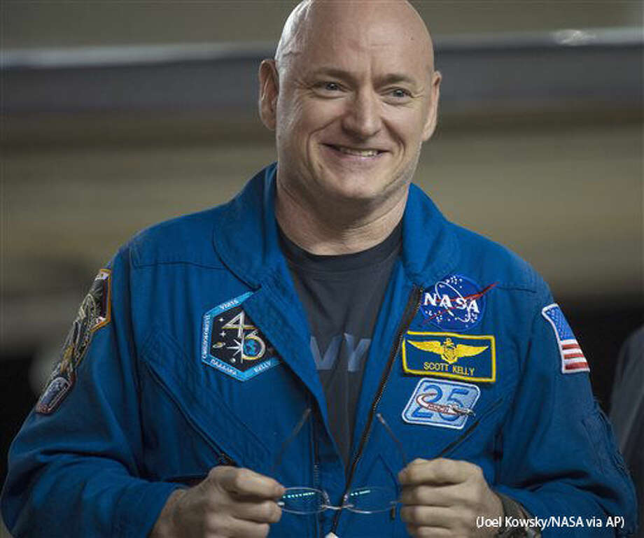 Expedition 46 Commander Scott Kelly of NASA smiles upon arriving at Ellington Field, Thursday, March 3, 2016 in Houston, Texas, after his return to Earth. The Soyuz TMA-18M spacecraft landed near the town of Dzhezkazgan, Kazakhstan, on Wednesday with Kelly and Russian cosmonauts Mikhail Kornienko and Sergey Volkov of Roscosmos. Kelly and Kornienko are completing an International Space Station record year-long mission to collect valuable data on the effect of long duration weightlessness on the human body that will be used to formulate a human mission to Mars. Volkov is returning after six months on the station. (Joel Kowsky/NASA via AP) Photo: Joel Kowsky