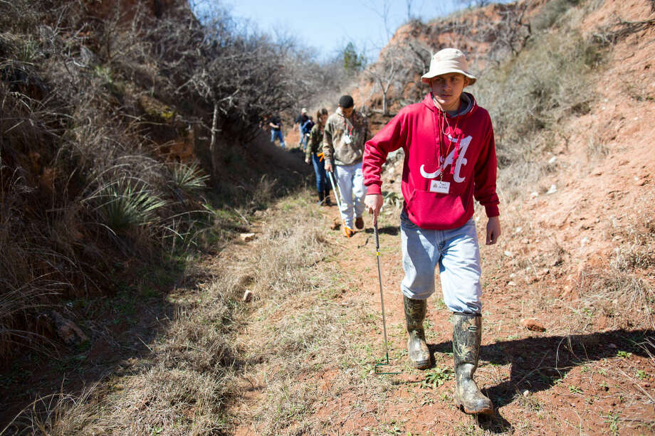 A group Friday morning walk through a canyon outside of Sweetwater Texas a rattlesnake hunt during the 2015 Sweetwater Jaycees World Largest Rattlesnake Roundup. Photo: Courtney Sacco