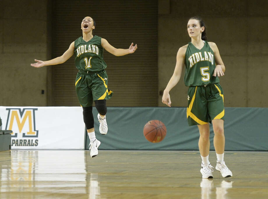 Midland College's Sierra Dixon (11) celebrates a win as Morgan Ashton (5) holds the ball while the clock runs out in overtime against Iowa Western's on Friday, Nov. 20, 2015, at Chaparral Center. James Durbin/Reporter-Telegram Photo: James Durbin