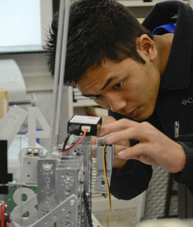 Ngun Ceu and other Lee High students work on their robots during class Monday. Tim Fischer\Reporter-Telegram Photo: Tim Fischer