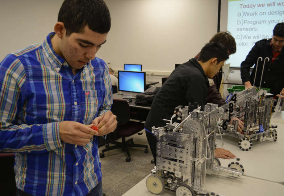 (File Photo) Christian Lozano works on cleaning up a new gear printed on a 3d printer for one of the MHS robots as other students work on other parts. Tim Fischer\Reporter-Telegram Photo: Tim Fischer