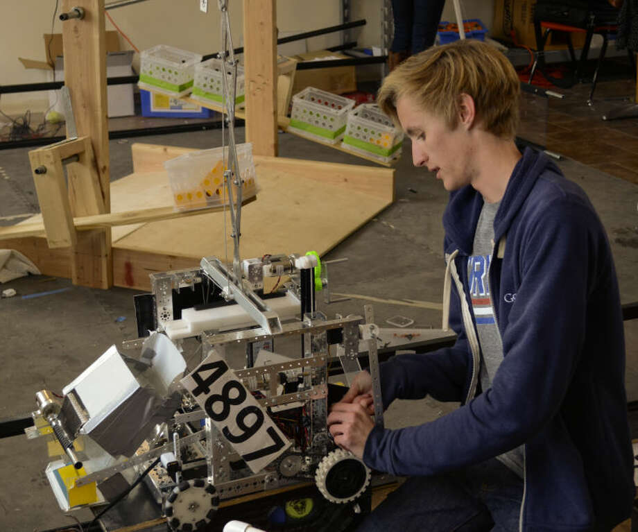 Axel Durham works on MHS's robot as they test and change the design of parts on the robot. Tim Fischer\Reporter-Telegram Photo: Tim Fischer
