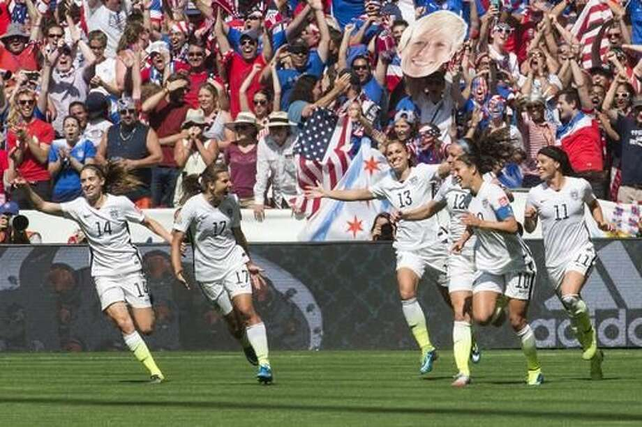 FILE - In this July 5, 2015 file photo, United States teammates, left to right, Morgan Brian (14), Tobin Heath (17), Alex Morgan (13), Lauren Holiday (12), Carli Lloyd (10) and Ali Krieger (11) celebrate after Lloyd's second goal against Japan during the first half of the FIFA Women's World Cup soccer championship in Vancouver, British Columbia, Canada. A federal judge in Chicago is set to make a high-stakes ruling to determine whether the world-champion U.S. women's soccer team has the right to strike before this year's Olympics. At the first status hearing in the case Thursday, March 3, 2016, a judge set May 25 for in-court arguments between the soccer federation and the players' union on the issue. (Jonathan Hayward/The Canadian Press via AP, File) MANDATORY CREDIT Photo: Jonathan Hayward