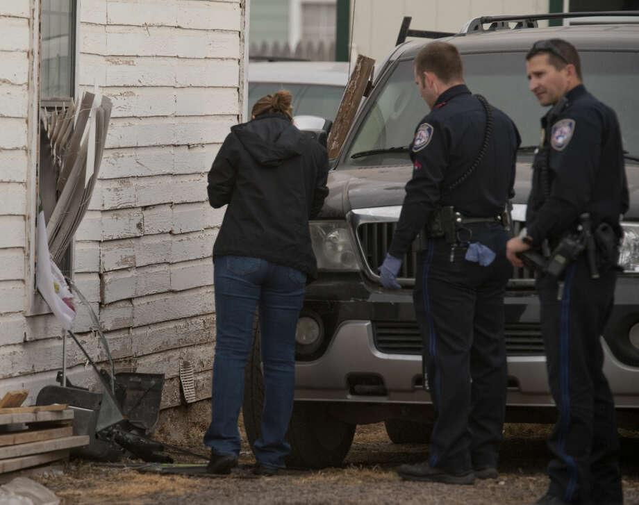 Midland police respond to a robbery Monday, 3-16-15, at 1206 W. Florida. Tim Fischer\Reporter-Telegram Photo: Tim Fischer
