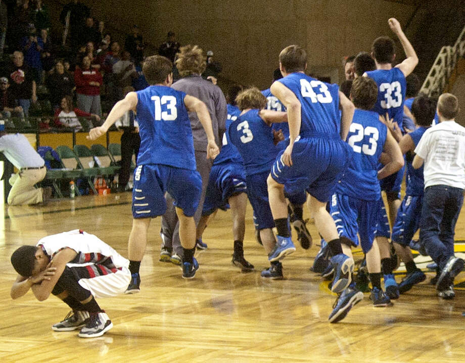 Childress players celebrate a win against Brownfield during the Region 1-3A championship game Saturday, March 7, 2015, at Chaparral Center. James Durbin/Reporter-Telegram Photo: James Durbin