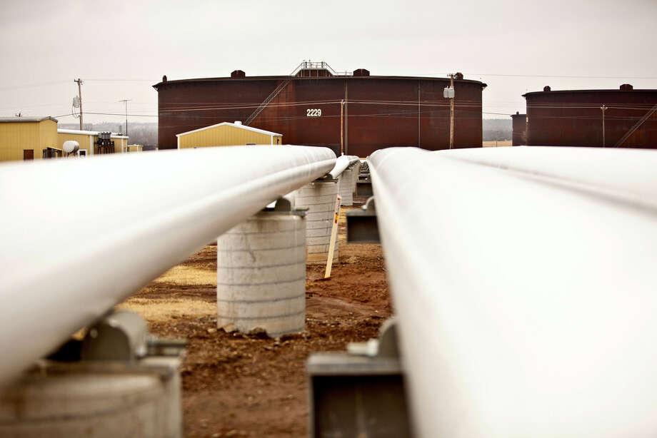 Oil pipelines run near storage tanks at the Enbridge Inc. Cushing Terminal in Cushing, Oklahoma, U.S. Photographer: Shane Bevel/Bloomberg Photo: Shane Bevel