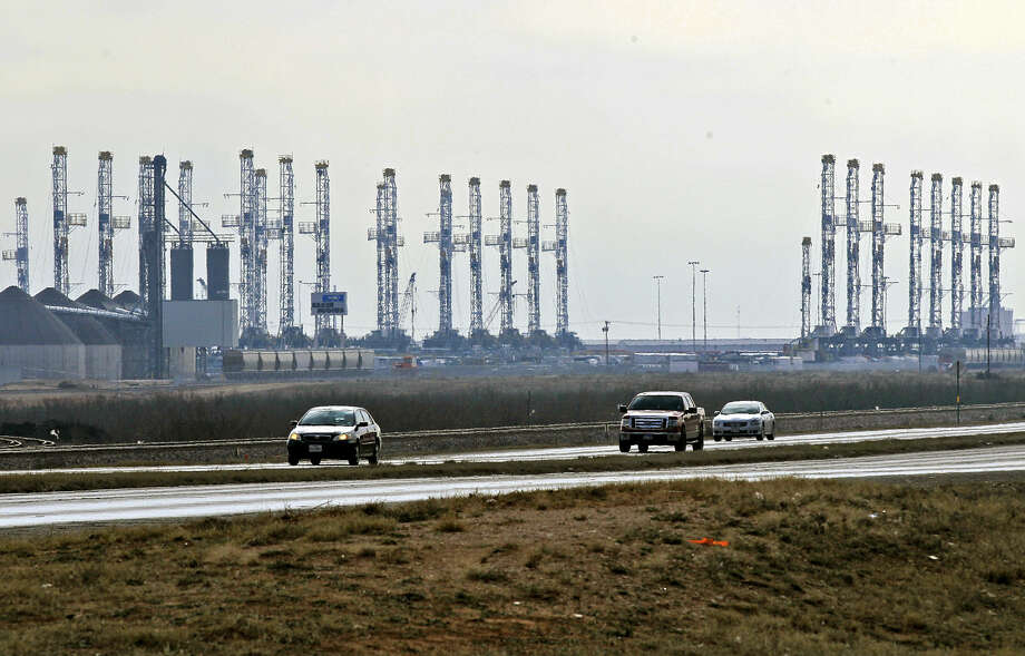 Rigs stacked along Business 20 west of FM 1788 photographed Tuesday, Feb. 24, 2015. James Durbin/Reporter-Telegram Photo: James Durbin
