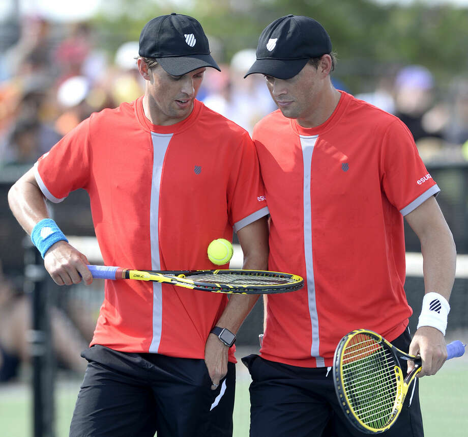 Mike Bryan (left) and his brother, Bob Bryan (right) put on a doubles exhibition during the West Texas Tennis Classic on Saturday, Sept. 26, 2015, at Bush Tennis Center. James Durbin/Reporter-Telegram Photo: James Durbin