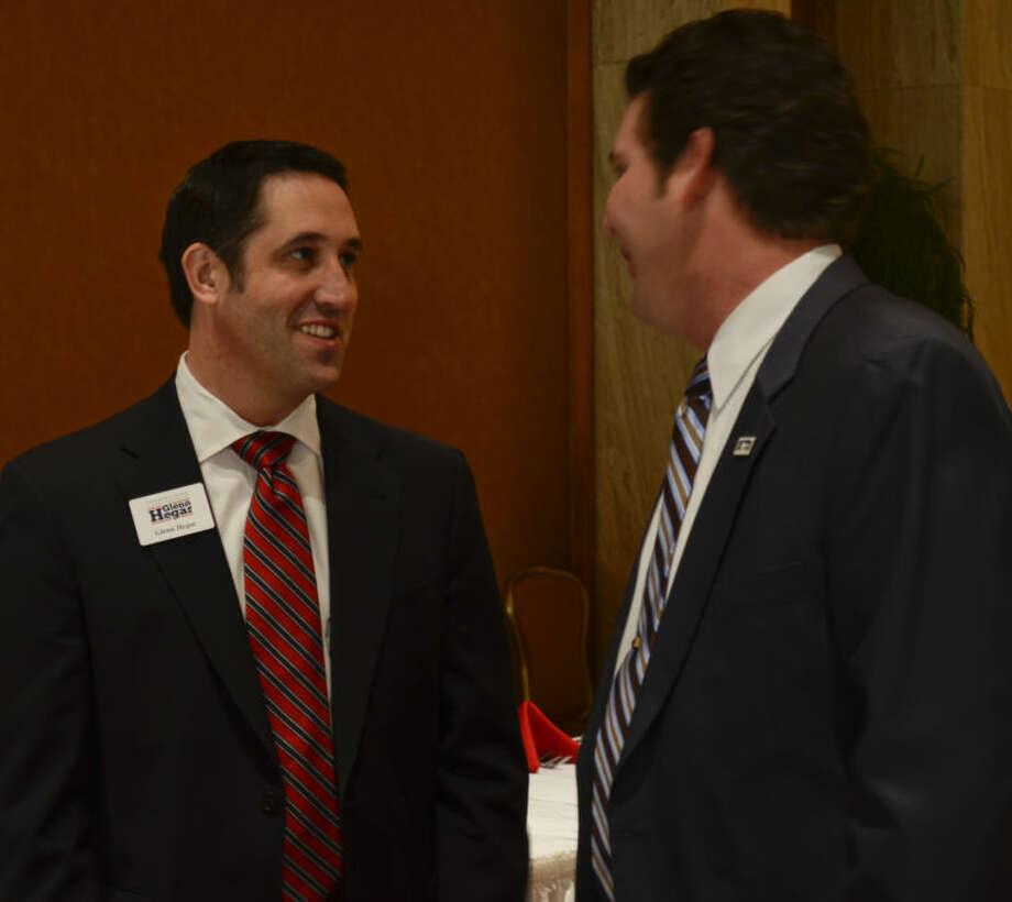 Texas Senator Glenn Hegar talks with Midland City Councilman J. Ross Lacy Wednesday at the Midland County Republican Women's luncheon. Tim Fischer\Reporter-Telegram Photo: Tim Fischer