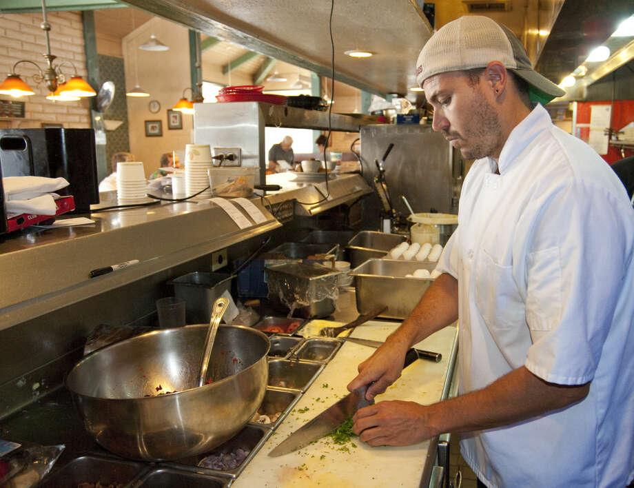 Chef Timm Rogers prepares a dish Tuesday, 6-9-15, at Lori's Cafe. Tim Fischer\Reporter-Telegram Photo: Tim Fischer