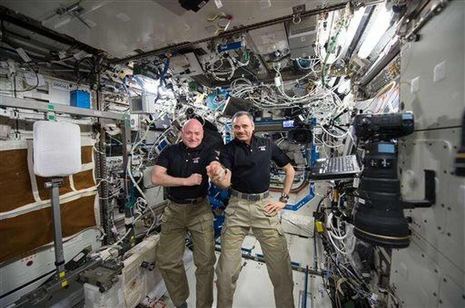 In this Jan. 21, 2016 photo made available by NASA, one-year mission crew members Scott Kelly of NASA, left, and Mikhail Kornienko of Roscosmos their 300th consecutive day in space. The pair will land March 1 after spending a total of 340 days in space. (NASA via AP) Photo: HOGP