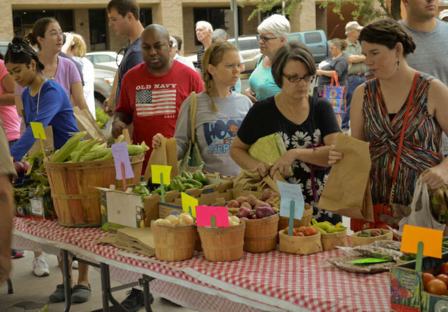 Patrons look over items available from different vendors at the Farmers Market Saturday morning. Tim Fischer\Reporter-Telegram Photo: Tim Fischer