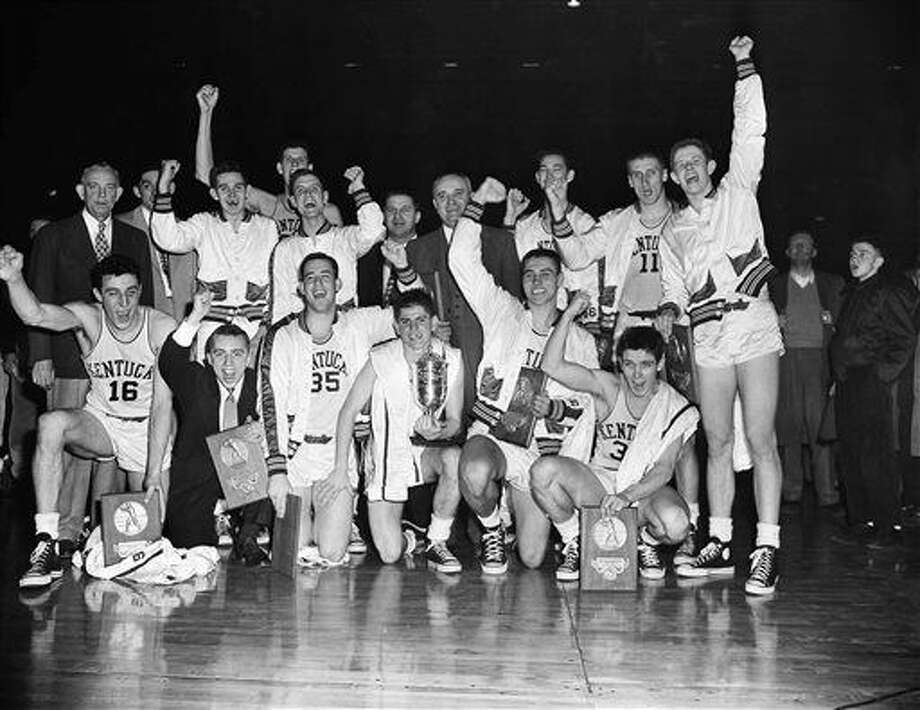 FILE - In this March 27, 1951, file photo, the Kentucky basketball team celebrates winning the NCAA college basketball championship after defeating Kansas State 68-58 in Minneapolis. In 1939, the national title was decided by an eight-team competition. In 2015, 68 teams will play in 14 venues across the country, every game will be on TV, and the championship game will be played in an NFL stadium while millions of people watch across the country and around the world. (AP Photo/Chet Magnuson, File) Photo: Chet Magnuson