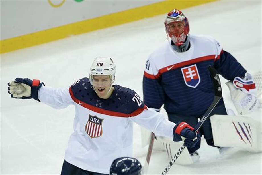 USA forward Paul Stastny celebrates his goal as Slovakia goaltender Jaroslav Halak looks on during the second period of the 2014 Winter Olympics men's ice hockey game at Shayba Arena, Thursday, Feb. 13, 2014, in Sochi, Russia. (AP Photo/Matt Slocum) Photo: Matt Slocum / AP