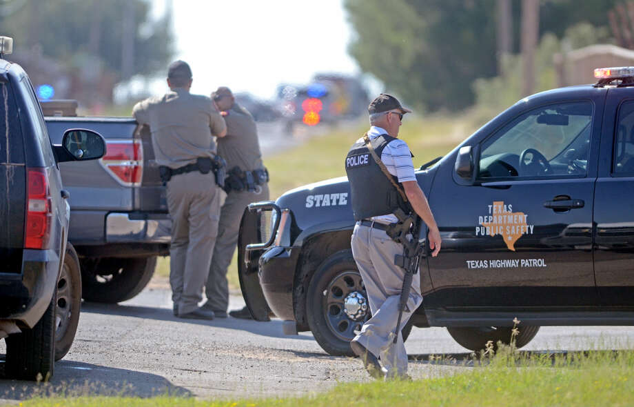 Midland emergency personnel respond to a standoff near Briarwood Avenue and Highway 158 on Thursday. Midland County Sheriff's Office Sgt. Mike Naylor was shot and killed while he was serving a warrant Thursday afternoon. Photo: James Durbin/Reporter-Telegram