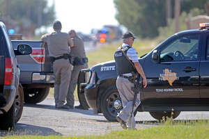 Midland emergency personnel respond to a standoff near Briarwood Avenue and Highway 158 on Thursday. Midland County Sheriff's Office Sgt. Mike Naylor was shot and killed while he was serving a warrant Thursday afternoon.