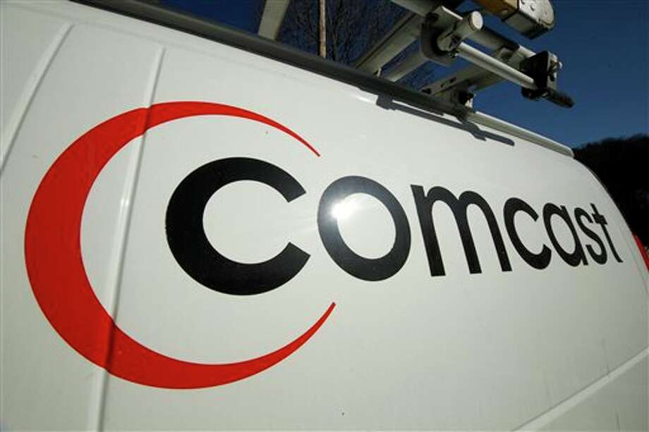 FILE - This Feb. 11, 2011 file photo shows the Comcast logo on one of the company's vehicles, in Pittsburgh. Comcast has agreed to buy Time Warner Cable for $45.2 billion in stock, or $158.82 per share, in a deal that would combine the top two cable TV companies in the nation, according to a person familiar with the matter who spoke on condition of anonymity because it had not been announced formally. An announcement is set for Thursday morning, Feb. 13, 2014, the person said. (AP Photo/Gene J. Puskar, File) Photo: Gene J. Puskar / A2011