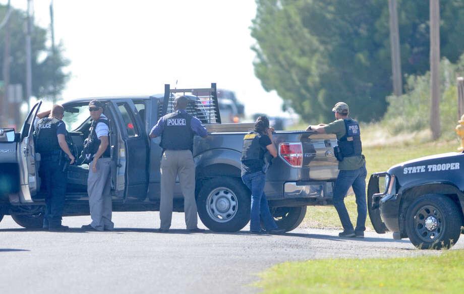 Midland emergency personnel respond to a standoff near Briarwod and 158 on Thursday. James Durbin/Reporter-Telegram Photo: James Durbin