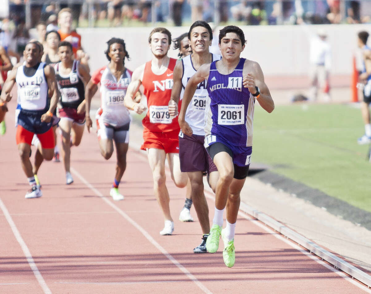 Midland junior Bryce Hoppel runs down the final lane of the 800M run during the UIL 6A Region 1/5A Region 2 Track and Field Championship on Saturday at Maverick Stadium in Arlington.