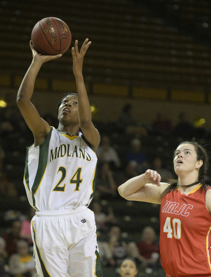 Midland College's Walnatia Wright (24) attempts to score against New Mexico Junior College's Daiane Machado (40) on Thursday, Feb. 18, 2016, at Chaparral Center. James Durbin/Reporter-Telegram Photo: James Durbin