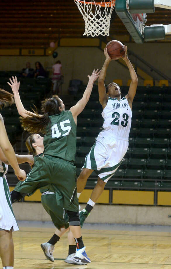 Midland College's Mary Savoy (23) scores against Western Texas' Brittany McPherson (30) and Tiffany Young (45) on Thursday at Chaparral Center. James Durbin/Reporter-Telegram Photo: JAMES DURBIN