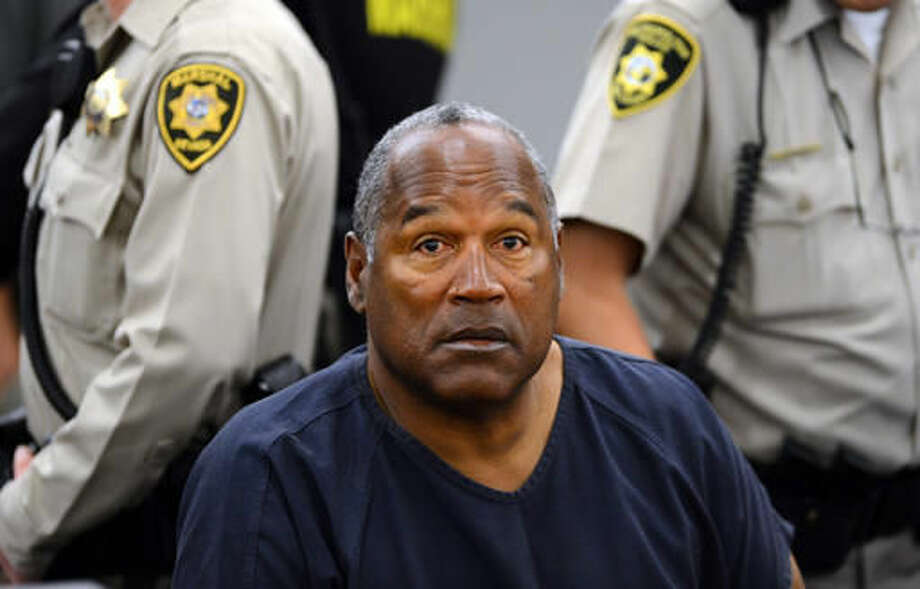 FILE - In this May 14, 2013, file photo, O.J. Simpson sits during a break on the second day of an evidentiary hearing in Clark County District Court in Las Vegas. Los Angeles police are investigating a knife purportedly found some time ago at the former home of Simpson, who was acquitted of murder charges in the 1994 stabbing deaths of his ex-wife Nicole Brown Simpson and her friend Ron Goldman. (AP Photo/Ethan Miller, Pool, File) Photo: Ethan Miller