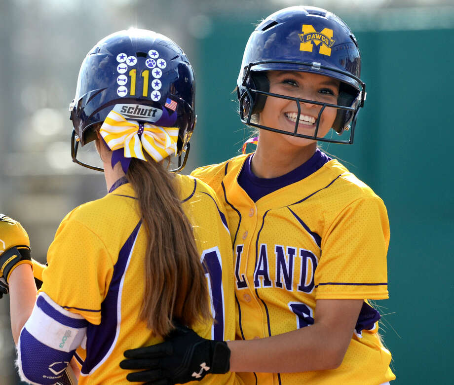 Midland High's Alyssa Flores (6) celebrates with teammate Aubree Rowley (11) after scoring against San Angelo Central on Thursday, March, 19, 2015, at Audrey Gill Sports Complex. Flores racked up 5 RBI during the Bulldogs 14-2 win over San Angelo. James Durbin/Reporter-Telegram Photo: James Durbin