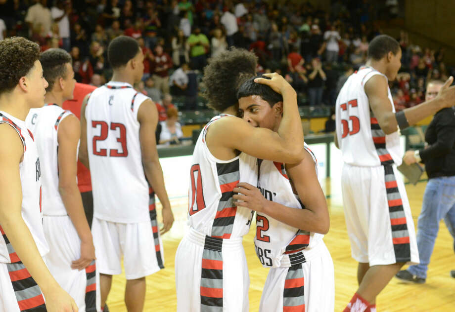Brownfield's Alex McCrary (30) and Brandon Reed (32) embrace after a win against Texas Leadership Charter Academy in the Region 1-3A semifinal game Friday, March 4, 2016, at Chaparral Center. James Durbin/Reporter-Telegram Photo: James Durbin
