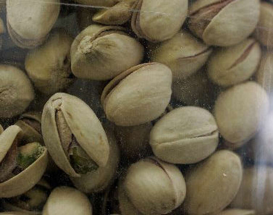 Close up of pistachios at a grocery store in Palo Alto, Calif., Tuesday, March 31, 2009. Federal food safety officials warned Monday that consumers should stop eating all foods containing pistachios while they figure out the source of a possible salmonella contamination. The company at the center of a nationwide pistachio recall says the salmonella contamination could have come from raw nuts during processing but not a human or animal source in its plant. (AP Photo/Paul Sakuma) Photo: (AP Photo/Paul Sakuma)