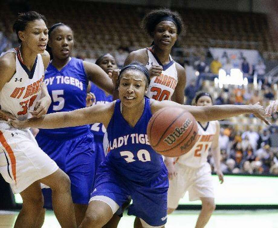 Tennessee State forward Chelsea, front, vies for a rebound during overtime of a game against Tennessee Martin in the final round of the Ohio Valley Conference tournament Saturday, March 7, 2015, in Nashville, Tenn. Tennessee State won 64-60. AP Photo/Mark Humphrey