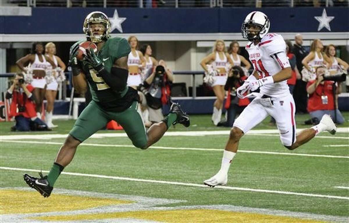Baylor Bears wide receiver Antwan Goodley (5) catches a first quarter touchdown pas in front of Texas Tech Red Raiders defensive back Justis Nelson (31) during the Texas Tech University Red Raiders vs. the Baylor University Bears NCAA football game in Arlington, TX on Saturday, Nov. 16, 2013. (AP Photo/Louis DeLuca/Dallas Morning News)