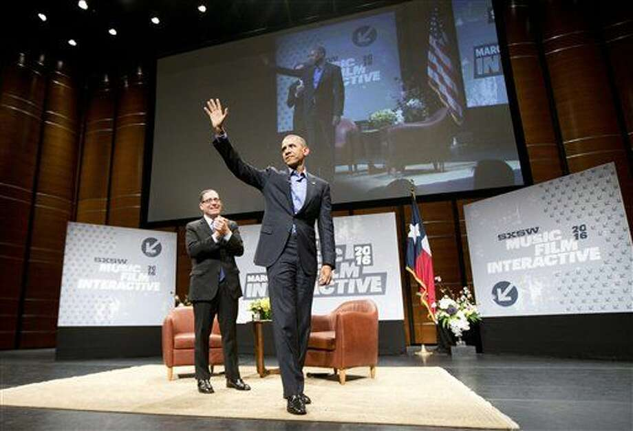 President Barack Obama, center, waves to members of the audience after answering question from Evan Smith, left, CEO / Editor in Chief of The Texas Tribune, at the South by Southwest Festival (SXSW) at the Center for Performing Arts in Austin, Texas, Friday, March 11, 2016. (AP Photo/Pablo Martinez Monsivais) Photo: Pablo Martinez Monsivais