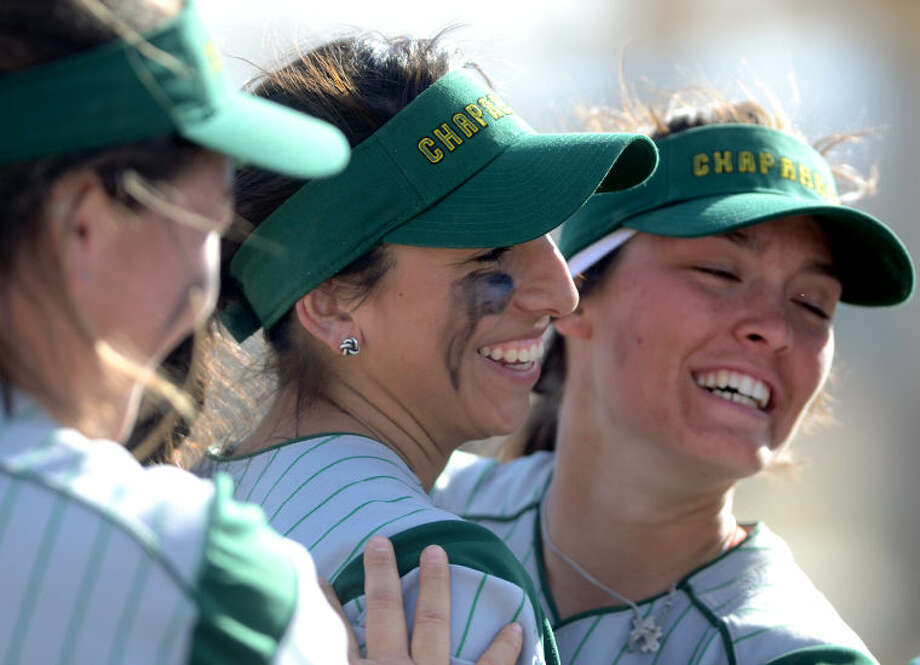 Midland College's Kelcey Gomez (left) and Taylor Daniels (right) embrace after the two strung together a double play to end the inning against Otero JC during the Midland College Classic tournament Friday at Freddie Ezell Softball Complex. James Durbin/Reporter-Telegram Photo: JAMES DURBIN