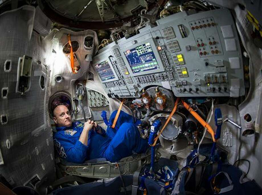 In this photo provided by NASA, astronaut Scott Kelly sits inside a Soyuz simulator at the Gagarin Cosmonaut Training Center (GCTC), Wednesday, March 4, 2015 in Star City, Russia. On Saturday, March 28, 2015, Kelly and cosmonaut Mikhail Kornienko will travel to the International Space Station to begin a year-long mission living in orbit. (AP Photo/NASA, Bill Ingalls) Photo: Bill Ingalls