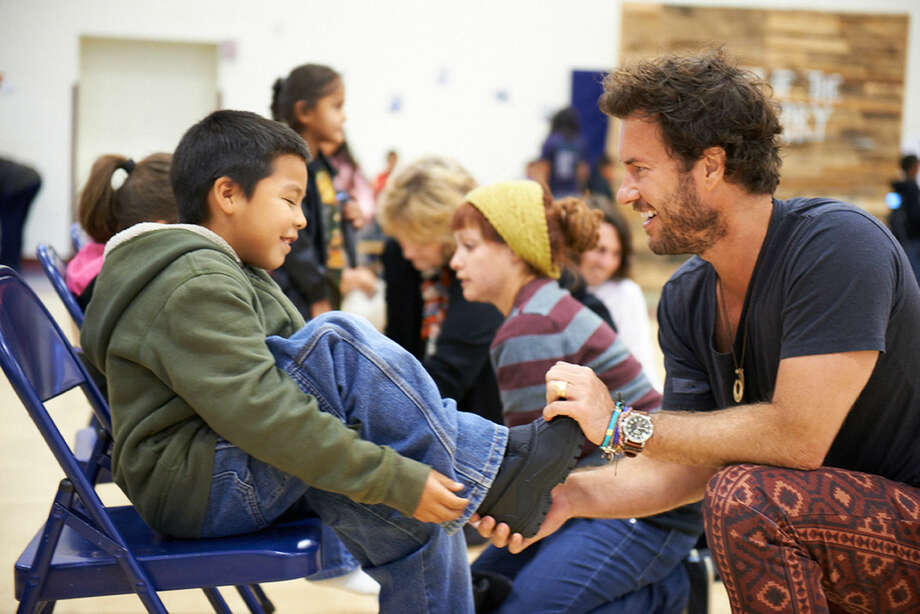 Blake Mycoskie of TOMS — a company that donates pairs of shoes or eyeglasses for each one purchased  — is visiting the college as part of the Davidson Distinguished Lecture Series next spring. Photo: Photo Courtesy Of Midland College