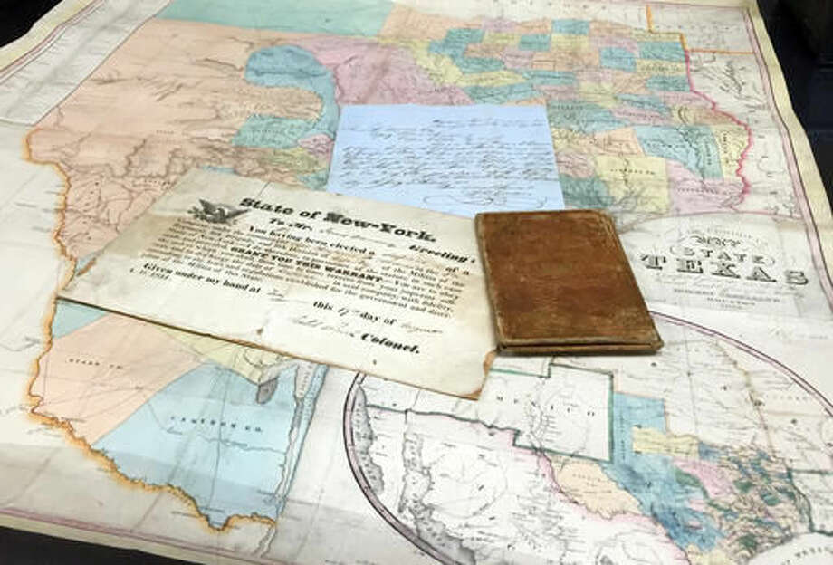 This photo provided by Heritage Auctions shows a 1853 copy of De Cordova's Map of Texas, accompanied by military documents and a letter to James M. Manning. A rare, early map of Texas and another historical document discovered in a box of sheet music purchased for $10 at an Indiana estate auction in the 1980s could sell for as much as $7,000 at auction. Heritage Auctions is offering the items Saturday, March 12, 2016 in Dallas.( Donna Helm/Heritage Auctions via AP) Photo: Donna Helm