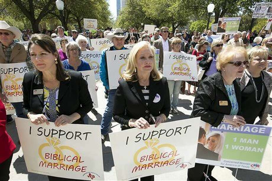 """From left to right, Cindy Asmussen, Jan Jones and Mary Smith, hold signs at a rally as they oppose gay marriage during a Defense of the Texas Marriage Amendment Rally outside of the state Capitol, Monday, March 23, 2015, in Austin, Texas. Hundreds of people gathered Monday afternoon at the Texas Capitol to rally in support of what they call """"Biblical marriage"""", a union between a man and a woman, at an event headlined by Alabama Supreme Court Chief Justice Roy Moore. (AP Photo/Austin American-Statesman, Ralph Barrera) AUSTIN CHRONICLE OUT, COMMUNITY IMPACT OUT, INTERNET AND TV MUST CREDIT PHOTOGRAPHER AND STATESMAN.COM, MAGS OUT Photo: Ralph Barrera"""