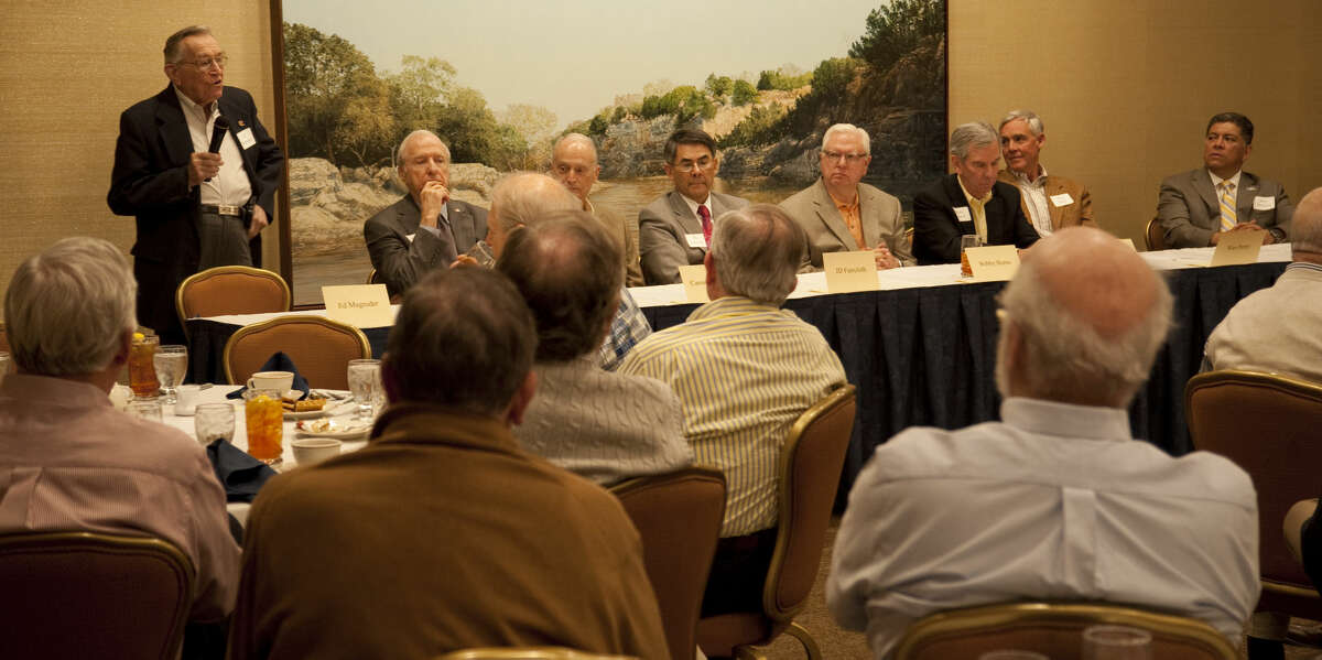 Midland past and present mayors, from left, Ed Magruder, Ernest Angelo, Carroll Thomas, JD Faircloth, Bobby Burns, Mike Canon, Wes Perry and current mayor Jerry Morales, speak Monday, 3-23-15, during the Exchange Club luncheon at the Petroleum Club. Tim Fischer\Reporter-Telegram