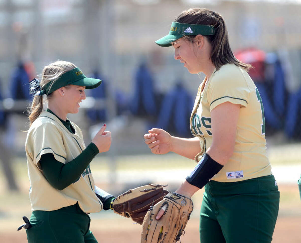 Midland College's Savannah Koke (3) and Tyneesha Houkamu (15) get ready to start an inning against North Central Texas College during the Midland College Classic tournament on Saturday at Freddie Ezell Softball Complex. James Durbin/Reporter-Telegram