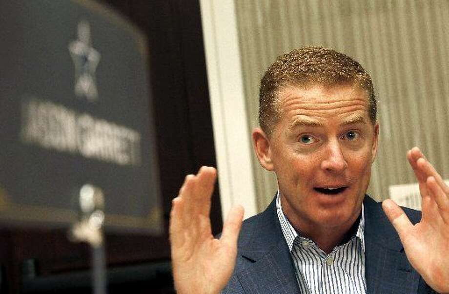 Dallas Cowboys head coach Jason Garrett explains his answer to a question as NFC football coaches meet with the media during the NFL's annual meeting, Wednesday in Phoenix.  Ross D. Franklin/AP Photo