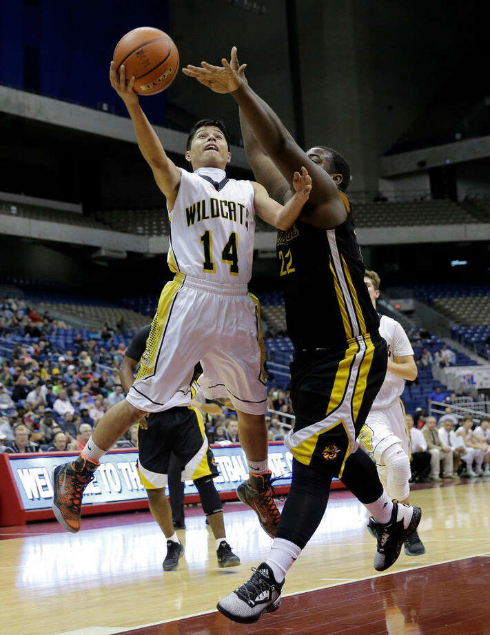 Grady's Alejandro Jimenez (14) drives to the basket against Coolidge's Darion McClendon (22) during a UIL Class 1A boys high school state semifinal basketball game, Thursday, March 10, 2016, in San Antonio. Grady won 64-58. (AP Photo/Eric Gay) Photo: Eric Gay | Associated Press