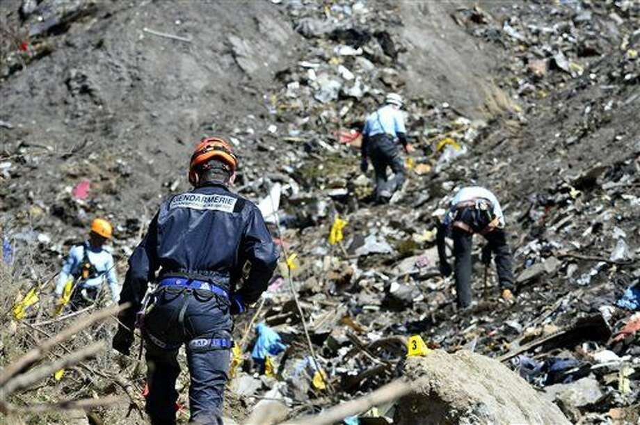In this undated photo provided by the French Interior Ministry, French emergency rescue services work at the site of the Germanwings jet that crashed on Tuesday, March 24, 2015 near Seyne-les-Alpes, France. The co-pilot of the Germanwings jet barricaded himself in the cockpit and intentionally rammed the plane full speed into the French Alps, ignoring the captain's frantic pounding on the door and the screams of terror from passengers, a prosecutor said Thursday. (AP Photo/French Interior Ministry, Francis Pellier) Photo: Francis Pellier
