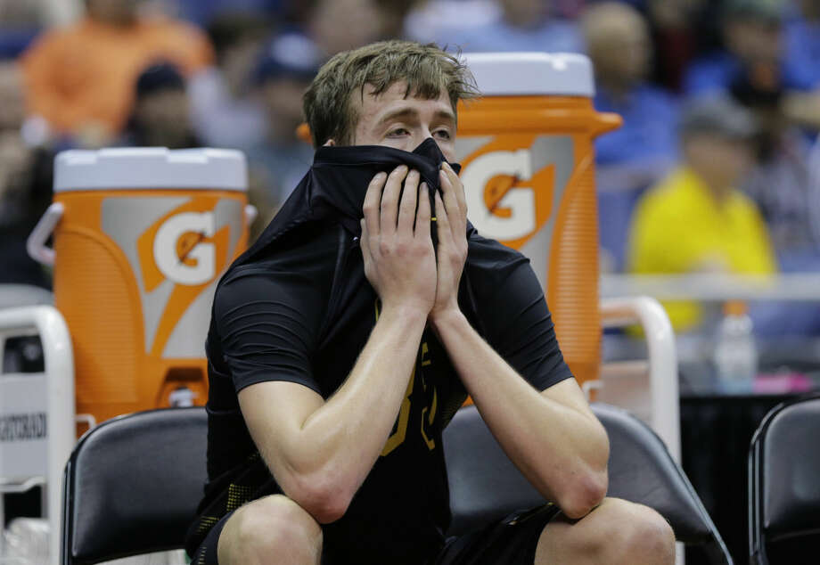Lenorah Grady's Cole Avery sits on the end of the bench after he fouled out during a UIL Class 1A boys high school state final basketball game, Saturday, March 12, 2016, in San Antonio. Avinger won 50-36. (AP Photo/Eric Gay) Photo: Eric Gay