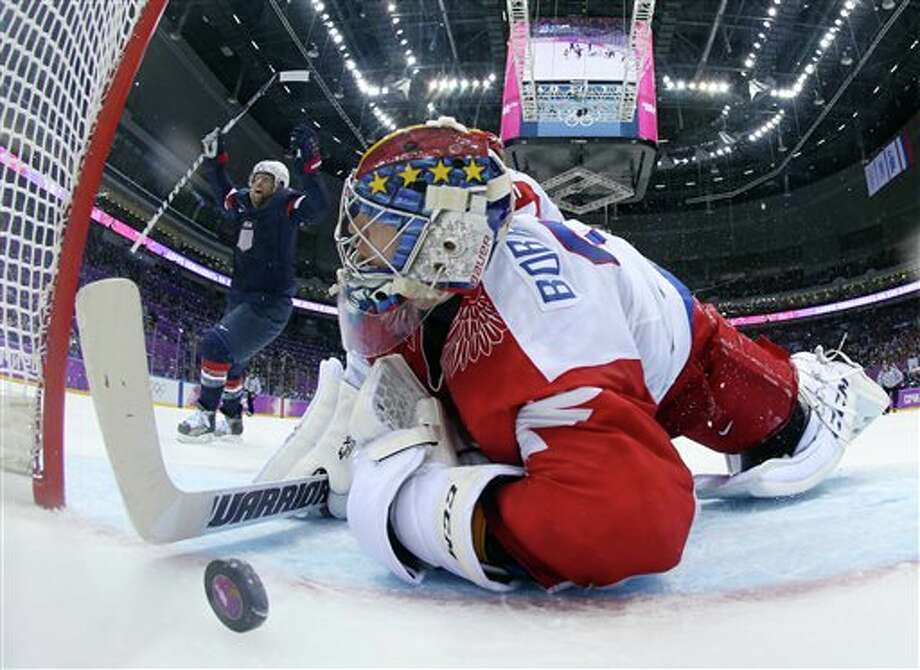 USA forward Phil Kessel reacts as Russia goaltender Sergei Bobrovski can't stop a goal by USA defenseman Cam Fowler during the second period of a men's ice hockey game at the 2014 Winter Olympics, Saturday, Feb. 15, 2014, in Sochi, Russia. (AP Photo/Bruce Bennett, Pool) Photo: Bruce Bennett / Pool Getty Images
