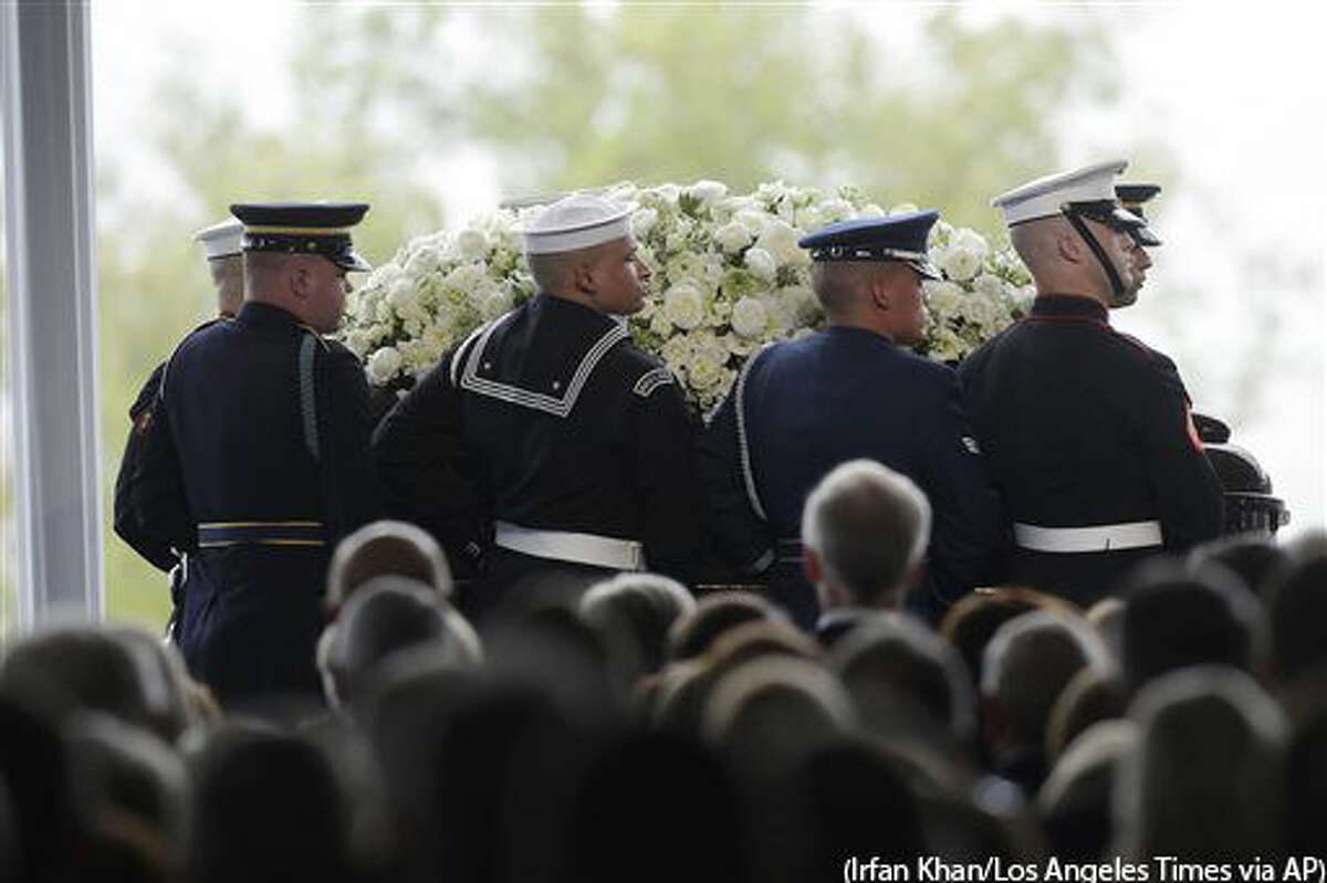 Pallbearers carry the casket of former First Lady Nancy Reagan during her funeral service at the Ronald Reagan Presidential Library, Friday, March 11, 2016 in Simi Valley, Calif. (Irfan Khan/Los Angeles Times via AP) NO FORNS; NO SALES; MAGS OUT; ORANGE COUNTY REGISTER OUT; LOS ANGELES DAILY NEWS OUT; INLAND VALLEY DAILY BULLETIN OUT; MANDATORY CREDIT, TV OUT
